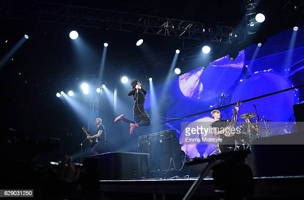 Hunter Burgan Davey Havok Jade Puget and Adam Carson of the band AFI perform onstage at 1067 KROQ Almost Acoustic Christmas 2016 Night 1 at The Forum...