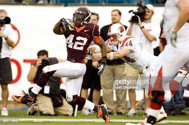 Hunter Cantwell of the Louisville Cardinals tries to force James Anderson of the Virginia Tech Hokies out of bounds after Anderson intercepted him...