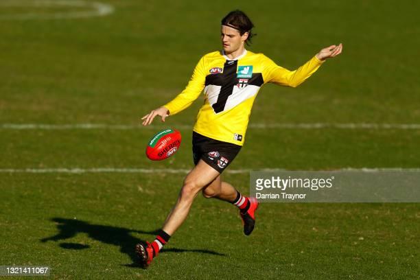 Hunter Clark of the Saints kicks the ball during a St Kilda Saints AFL training session at RSEA Park on June 03, 2021 in Melbourne, Australia.