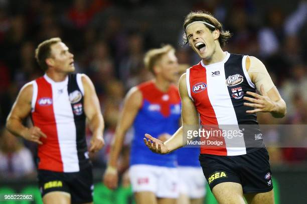 Hunter Clark of the Saints reacts after missing a goal during the round seven AFL match between St Kilda Saints and the Melbourne Demons at Etihad...