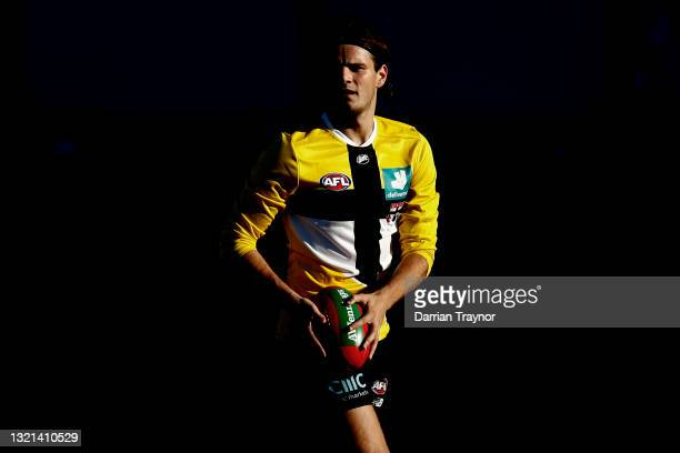 Hunter Clark of the Saints runs with the ball during a St Kilda Saints AFL training session at RSEA Park on June 03, 2021 in Melbourne, Australia.