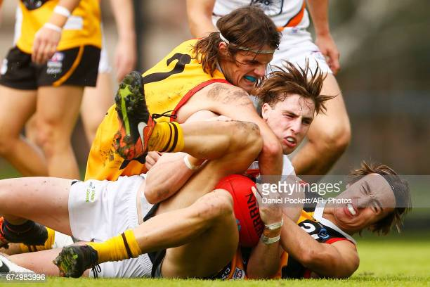 Hunter Clark of the Stingrays Dylan Landt of the Cannons and Jackson Allen of the Stingrays contest the ball during the round five TAC Cup match...