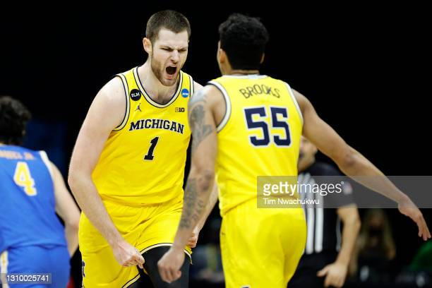 Hunter Dickinson of the Michigan Wolverines celebrates during the second half against the UCLA Bruins in the Elite Eight round game of the 2021 NCAA...