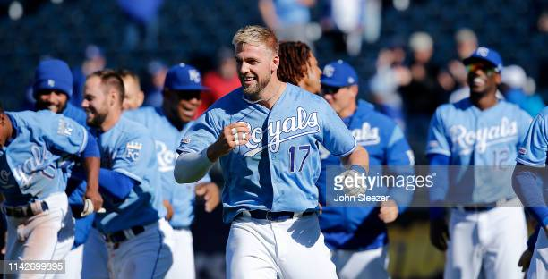 Hunter Dozier of the Kansas City Royals celebrates his gamewinning single in the ninth inning to score Terrance Gore from third for a 98 win against...