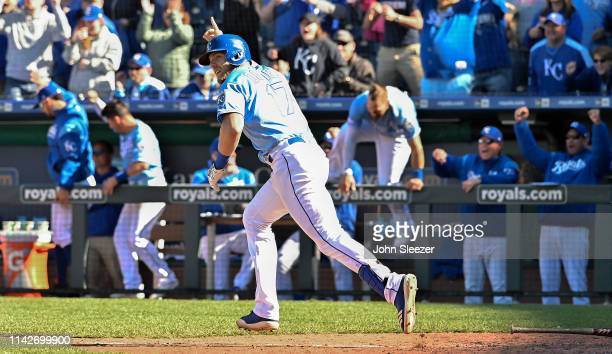 Hunter Dozier of the Kansas City Royals celebrates his gamewinning single to score Terrance Gore from third in the ninth inning for a 98 win against...