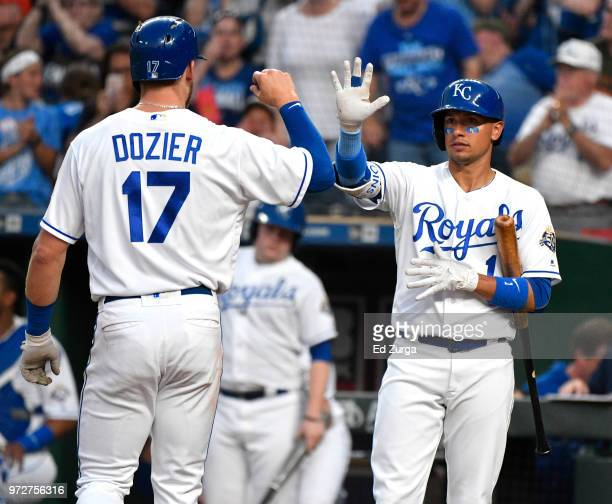 Hunter Dozier of the Kansas City Royals celebrates his home run with Ryan Goins in the fifth inning against the Cincinnati Reds at Kauffman Stadium...