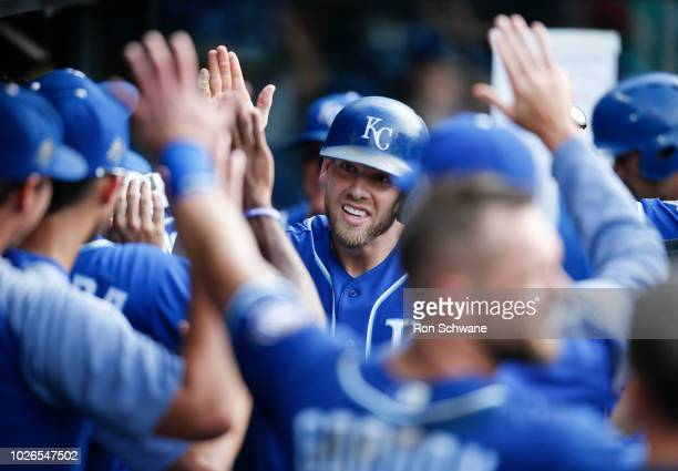 Hunter Dozier of the Kansas City Royals celebrates in the dugout after hitting solo home run off Jon Edwards of the Cleveland Indians during the...