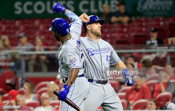 Hunter Dozier of the Kansas City Royals celebrates with Brian Goodwin after hitting the game winning home run in the 9th inning against the...