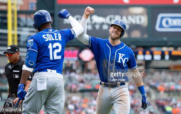 Hunter Dozier of the Kansas City Royals celebrates with Jorge Soler after hitting a solo home run in the eighth inning during the game against the...
