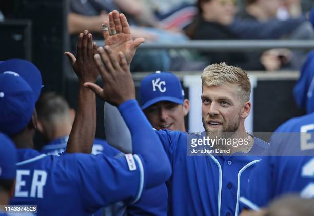 Hunter Dozier of the Kansas City Royals celebrates with teammates in dugout after hitting the gamewinning home run in the 10th inning against the...