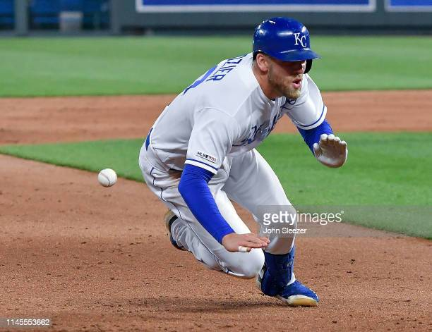 Hunter Dozier of the Kansas City Royals dives for third on a two run triple in the fifth inning during the game against the Los Angeles Angels of...