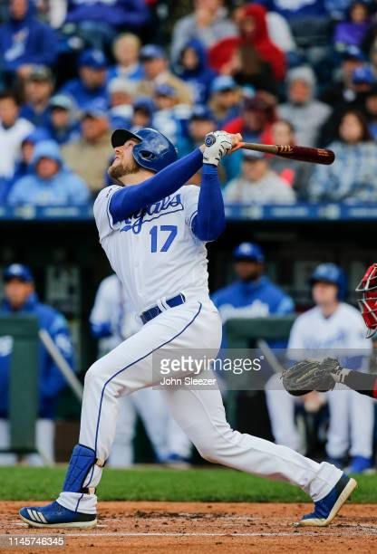 Hunter Dozier of the Kansas City Royals follows through in the first inning during the game against the Los Angeles Angels of Anaheim at Kauffman...