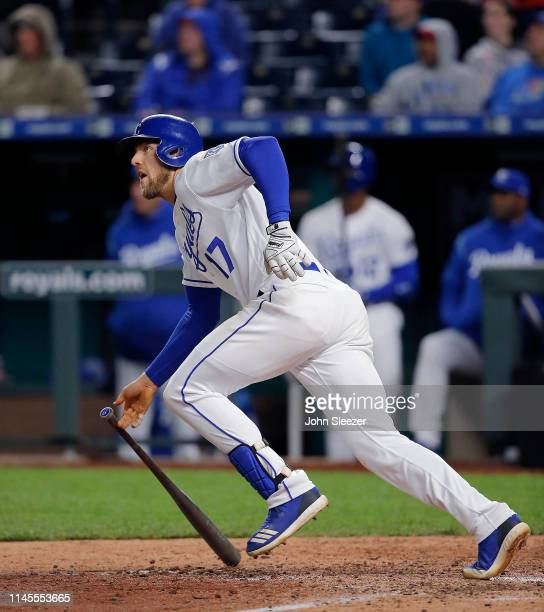 Hunter Dozier of the Kansas City Royals follows through on a two run triple in the fifth inning during the game against the Los Angeles Angels of...