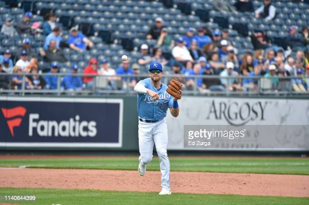 Hunter Dozier third baseman of the Kansas City Royals throws to first against the Minnesota Twins at Kauffman Stadium on April 3 2019 in Kansas City...