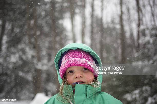 Hunter Francis plays outside in the snow at her home in Falmouth