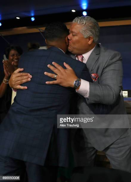 Hunter Greene hugs his dad after being selected second overall by the Cincinnati Reds during the 2017 Major League Baseball Draft at Studio 42 at the...