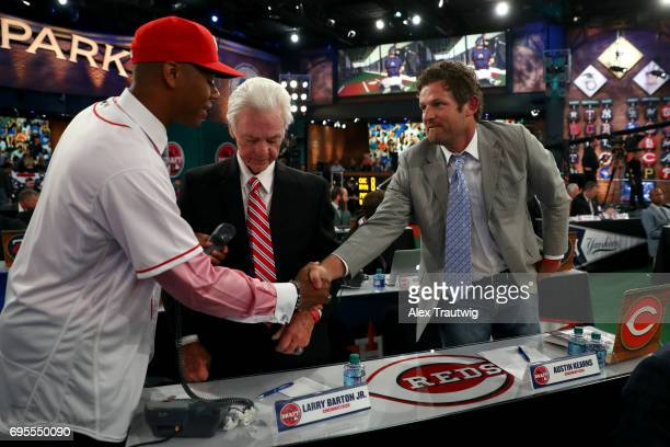 Hunter Greene shakes hands with Austin Kearns after being selected second overall by the Cincinnati Reds during the 2017 Major League Baseball Draft...