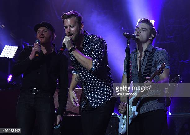 Hunter Hayes Eric Paslay and Charles Kelley perform at Hunter Hayes 2nd Annual CMA Awards Week Street Party on November 2 2015 in Nashville Tennessee