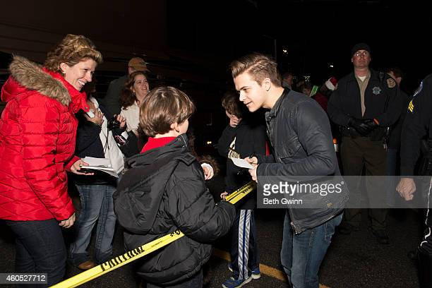 Hunter Hayes signs autographs outside of his bus during the 2014 Christmas 4 Kids Tour Bus Show at Walmart on December 15 2014 in Henderson Tennessee