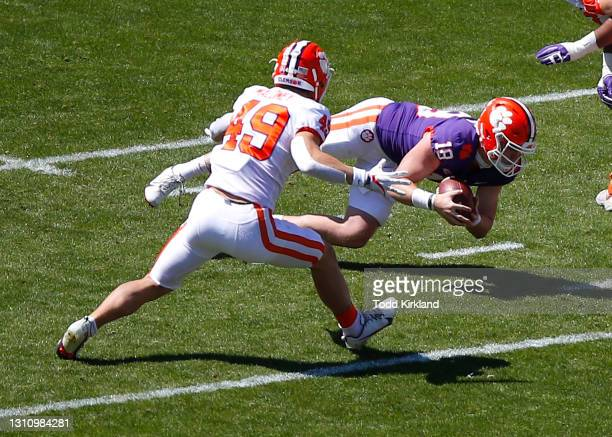 Hunter Helms of the Clemson Tigers dives on the ball as Matthew Maloney of the Clemson Tigers pursues during the second half of the Clemson Orange...