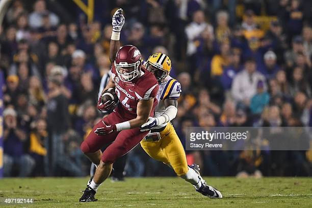 Hunter Henry of the Arkansas Razorbacks is brought down by Arden Key of the LSU Tigers during the first quarter of a game at Tiger Stadium on...