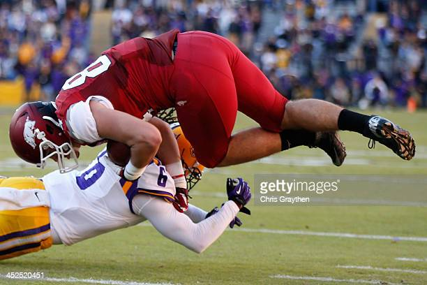 Hunter Henry of the Arkansas Razorbacks is tackled by Craig Loston of the LSU Tigers at Tiger Stadium on November 29 2013 in Baton Rouge Louisiana