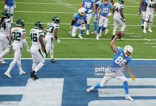 Hunter Henry of the Los Angeles Chargers spikes the ball after scoring a touchdown during the first half against the New York Jets at SoFi Stadium on...