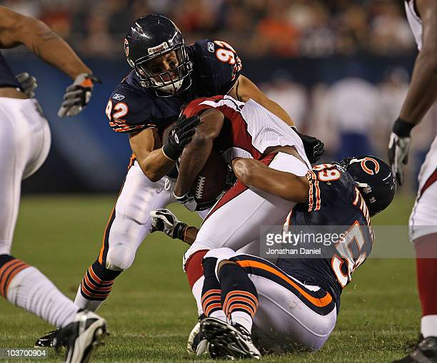 Hunter Hillenmeyer and Pisa Tinoisamoa of the Chicago Bears tackle Tim Hightower of the Arizona Cardinals during a preseason game at Soldier Field on...