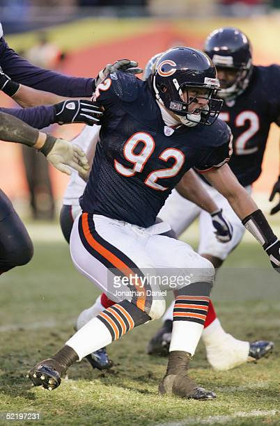 Hunter Hillenmeyer of the Chicago Bears reacts during a play against the Houston Texans on December 5 2004 at Soldier Field in Chicago Illinois The...