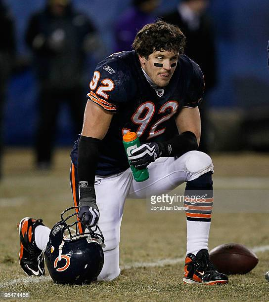Hunter Hillenmeyer of the Chicago Bears rests during a timeout in the final seconds of regulation of a game against Minnesota Vikings at Soldier...