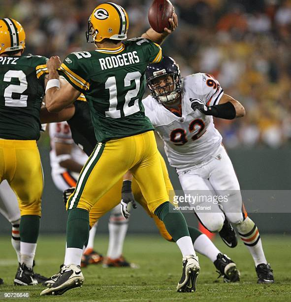 Hunter Hillenmeyer of the Chicago Bears rushes Aaron Rodgers of the Green Bay Packers on September 13 2009 at Lambeau Field in Green Bay Wisconsin...