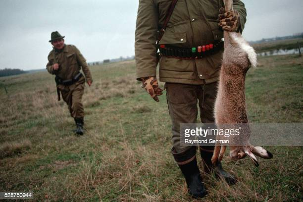 hunter holding dead rabbit - bialowieza forest stock pictures, royalty-free photos & images