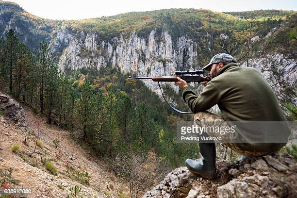 hunter in the mountains - man on fire stock photos and pictures