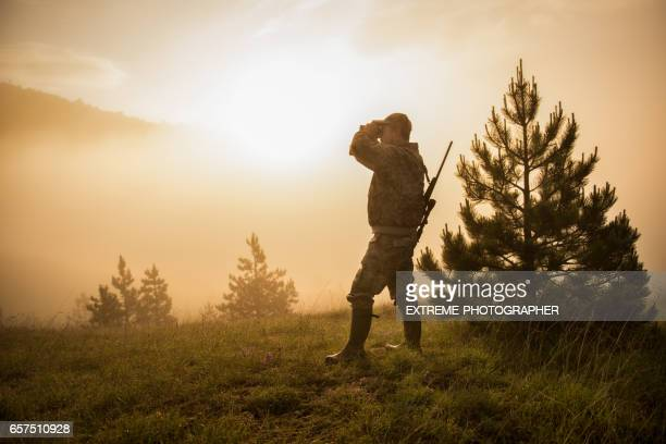 hunter in the nature - camouflage clothing stock pictures, royalty-free photos & images