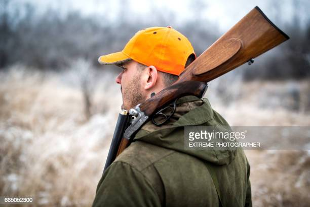 hunter in the woods - ammunition stock pictures, royalty-free photos & images