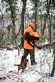 hunter forest with rifle hunting dog