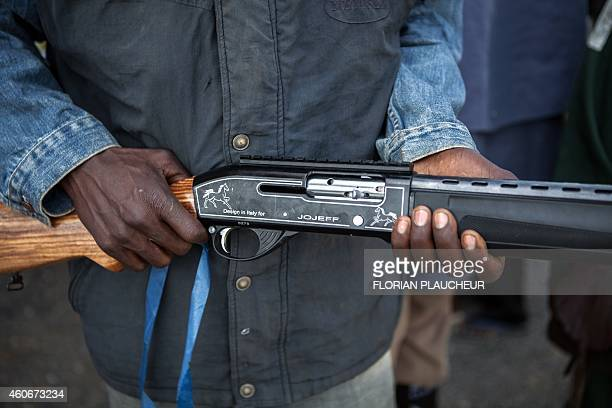 A hunter is pictured in Yola state capital of Adamawa on December 4 2014 after taking part in an operation against Nigerian Islamist extremist group...