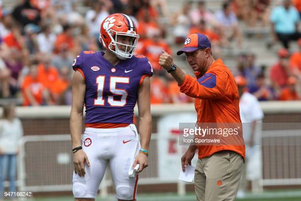 Hunter Johnson listens to head coach Dabo Swinney between plays at the Clemson Spring Football game at Clemson Memorial Stadium on April 14 2018 in...