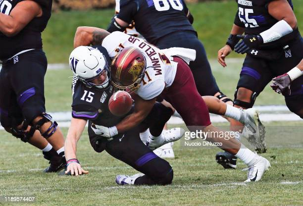 Hunter Johnson of the Northwestern Wildcats is sacked by Antoine Winfield Jr #11 of the Minnesota Golden Gophers during the first half at Ryan Field...