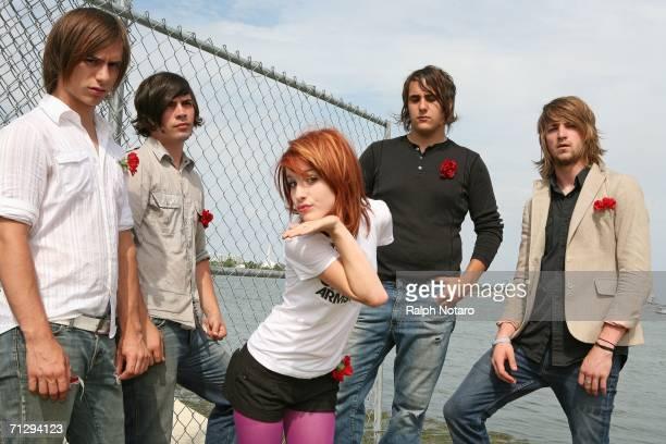 Hunter Lamb, Josh Farro, Haley Williams, Jeremy Davis, and Zac Farrro of Paramore pose for photos during the Vans Warped Tour at Bicentennial Park on...