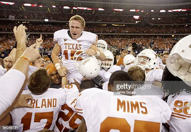 Hunter Lawrence of the Texas Longhorns celebrates with his team after kicking the gamewinning field goal to win the game 106 over the Nebraska...