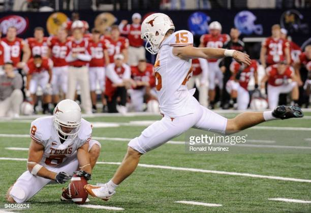 Hunter Lawrence of the Texas Longhorns kicks the gamewinning field goal against the Nebraska Cornhuskers in the final minutes of the game at Cowboys...