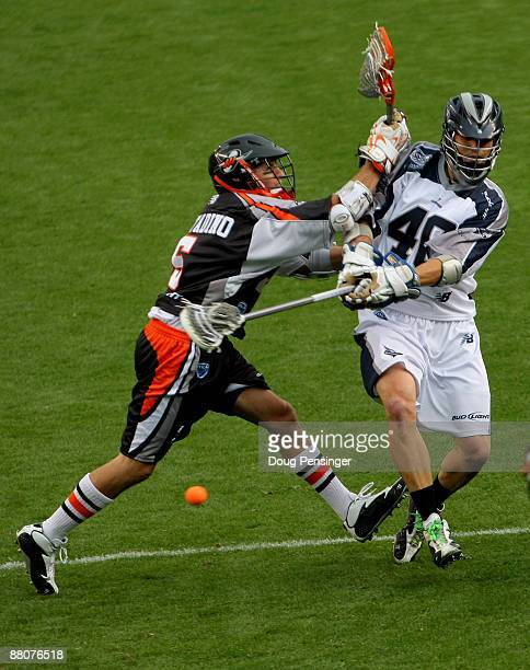Hunter Lochte of the Washington Bayhawks takes a shot on goal past Casey Cittadino of the Denver Outlaws during Major League Lacrosse action at...