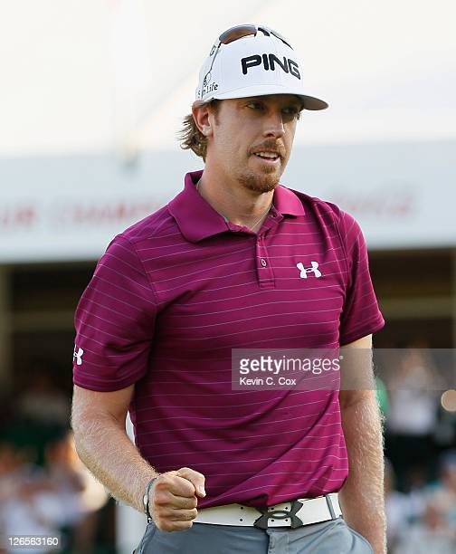 Hunter Mahan celebrates a par saving putt on the 18th green during the final round of the TOUR Championship at East Lake Golf Club on September 25...