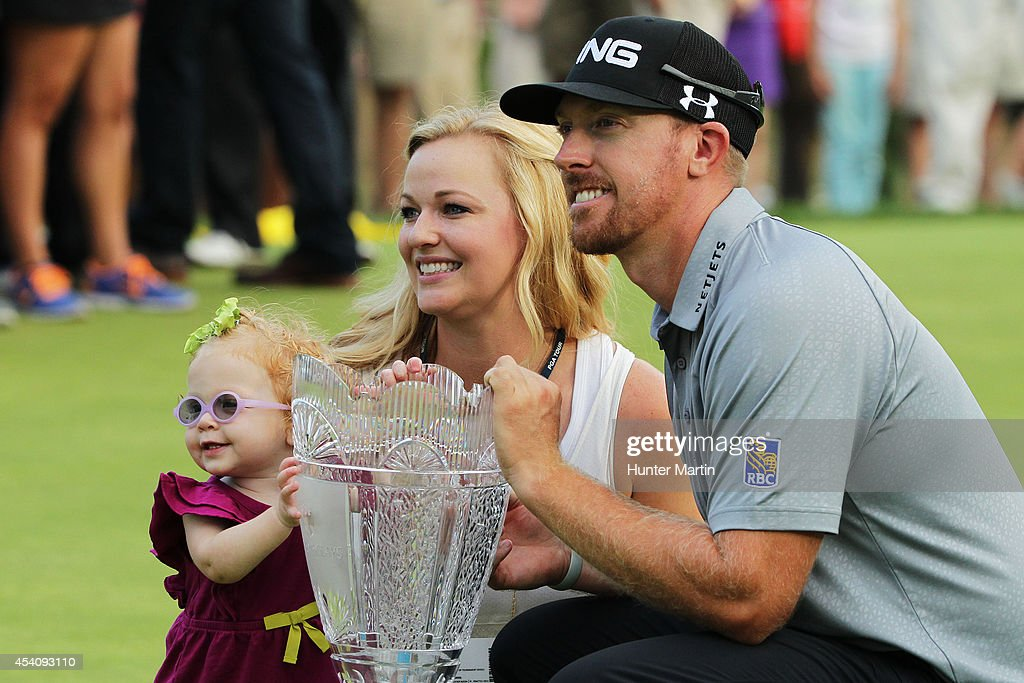 Hunter Mahan celebrates with his wife Kandi, daughter Zoe and the tournament trophy after winning of The Barclays at The Ridgewood Country Club on August 24, 2014 in Paramus, New Jersey.