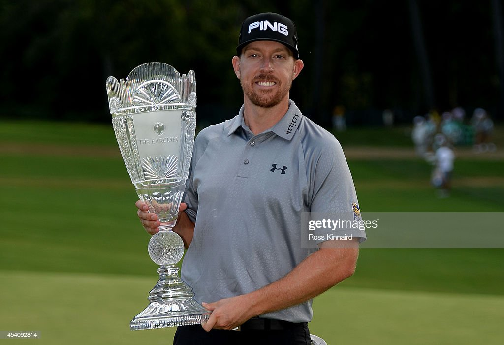 Hunter Mahan celebrates with the tournament trophy after winning of The Barclays at The Ridgewood Country Club on August 24, 2014 in Paramus, New Jersey.