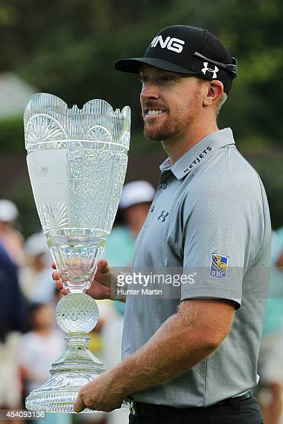 Hunter Mahan celebrates with the tournament trophy after winning of The Barclays at The Ridgewood Country Club on August 24 2014 in Paramus New Jersey