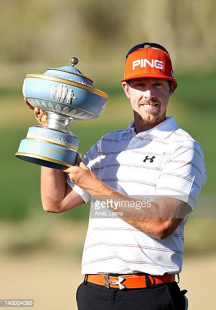 Hunter Mahan celebrates with the Walter Hagen Cup after winning the championship match during the final round of the World Golf...