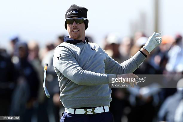 Hunter Mahan drops his club as after he hit a shot from the fairway on the eighth hole during the final round of the World Golf Championships...