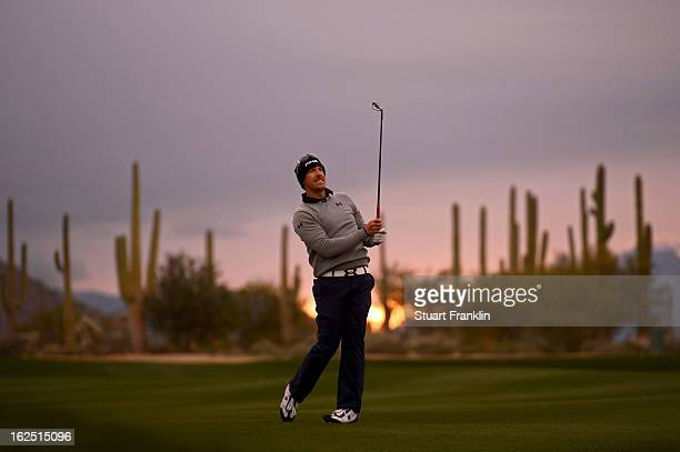 Hunter Mahan hits a shot from the fairway on the first hole during the semifinal round of the World Golf Championships Accenture Match Play at the...